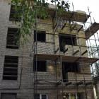 Рабочие восстановили два этажа в пострадавшем от взрыва доме на Крупской
